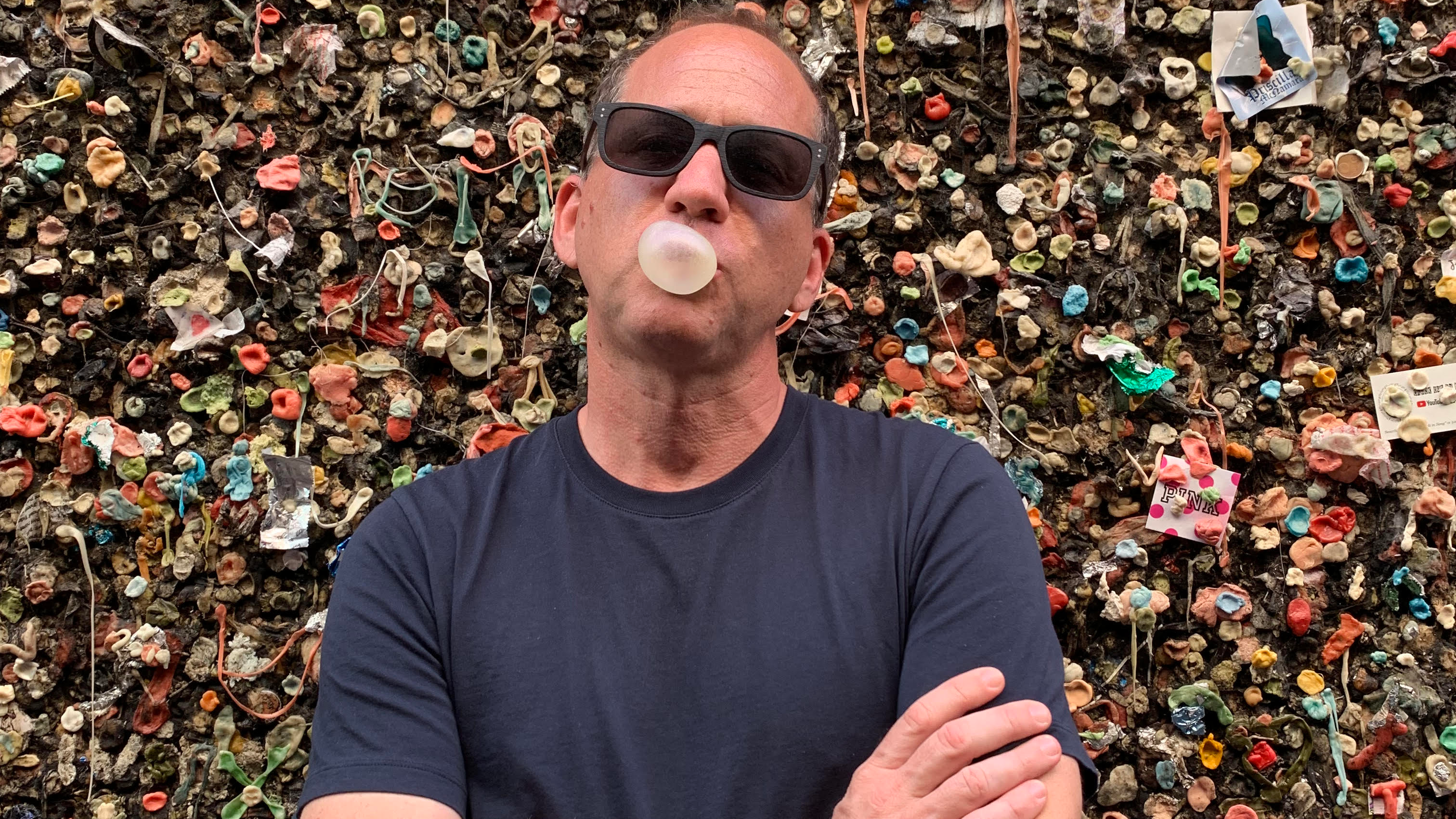 Brian Drewes in front of a wall of gum