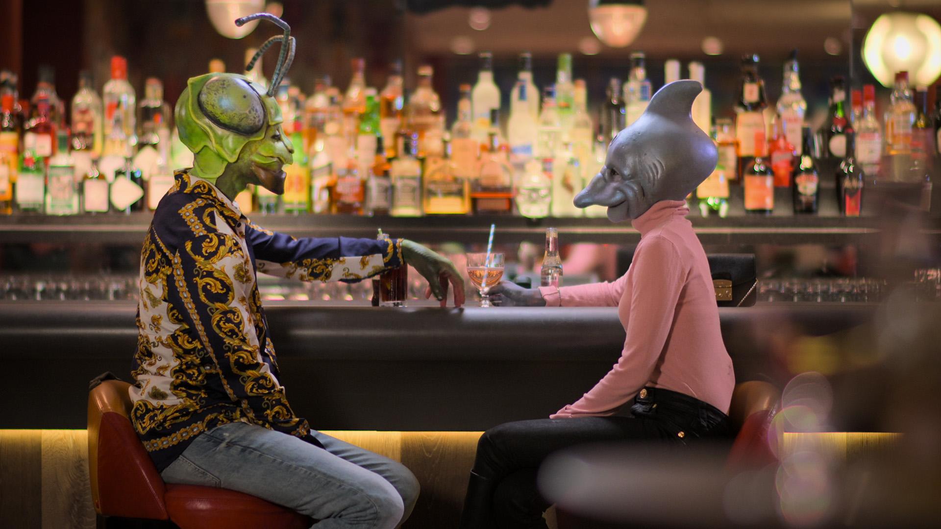 two contesants talk at a bar, Sexy Beasts