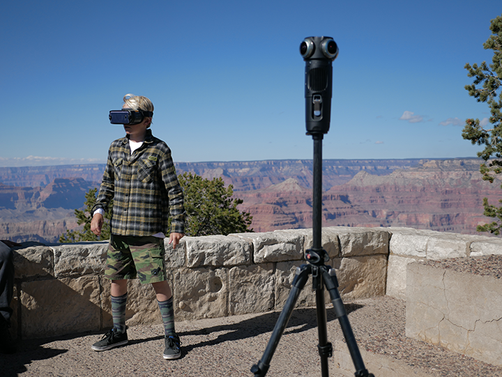 Child wearing VR headset at Grand Canyon