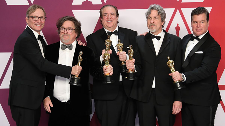 Green Book team with its Best Picture Oscars
